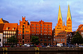 The Holstenhafen on the river Untertrave with St. Mary's church in the evening, Luebeck, Schleswig Holstein, Germany, Europe