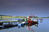 Fishing boat at jetty, Gobbiner Haken, Rugen island, Mecklenburg-Western Pomerania, isle of Rügen, Germany