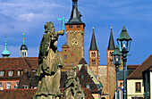 Europe, Germany, Bavaria, Würzburg, Alte Mainbrücke with statues in front of Cathedral Saint Kilian