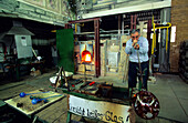 Europe, Germany, Bavaria, Zwiesel, glassblower at the glass lab