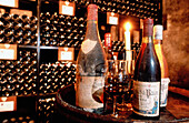 Old bottles in a Cellar. Beaune. Burgundy. France