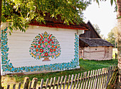 Hand painted flowers on house in picturesque Zalipie of Poland