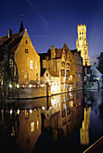 Canal scene with the Belfry in background. Brugge, Belgium