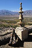 Tikse Gompa tibetan buddhist monastery, roof ornament, trumpets, scenery. Ladakh. Jammu & Kashmir. India.