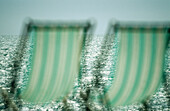 Beach, Beach chair, Beach chairs, Beaches, Blurred, Calm, Calmness, Chill out, Chilling out, Color, Colour, Concept, Concepts, Contemporary, Daytime, Deck chair, Deckchair, Empty, Exterior, Green, Holiday, Holidays, Horizontal, Leisure, Nobody, Object, Ob