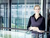 Businesswoman smiling at camera, Munich, Bavaria, Germany