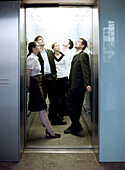 People standing in elevator, Munich, Bavaria, Germany