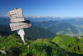 sign post on Hochgern with view to Kaiser range and Loferer Steinberge range, Chiemgau range, Chiemgau, Upper Bavaria, Bavaria, Germany