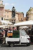 Market at Campo de Fiori with Giordano Bruno monument, Rome, Italy