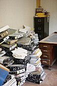 Abandoned, Abandonment, Aged, Business, Cardboard, Color, Colour, Concept, Concepts, Contemporary, Daytime, File, Files, Heap, Heaped, Heaps, Indoor, Indoors, Interior, Many, Office, Office equipment, Office supplies, Offices, Old, Pasteboard, Pile, Piled