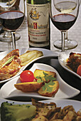 Food: 'Confits', with a Listrac-Medoc wine of the Bordeaux wine district, at 'Auberge Des Vignerons', at Listrac. Gironde. France.