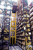 Arrangement, Automated, Automatised, Automatized, Box, Boxes, Color, Colour, Freight transportation, Height, Indoor, Indoors, Industrial, Industry, Interior, Load, Logistic, Logistics, Machinery, Metal, Order, Shelf, Shelves, Shelving, Shipping, Storage,