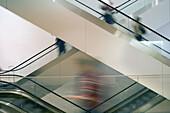 People on escalators, Museum of Modern Art, midtown Manhattan, NYC, USA