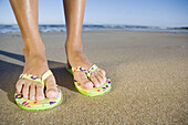 Accessories, Accessory, Adult, Adults, Beach, Beaches, Color, Colour, Contemporary, Daytime, Detail, Details, Exterior, Feet, Female, Feminine, Foot, Holiday, Holidays, Human, Leisure, One, One person, Outdoor, Outdoors, Outside, People, Person, Persons,
