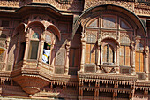 Carved windows and arches in stonework, Meherangarh Fort. Jodhpur. Rajasthan. India.