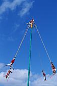 Voladores' (flyers) perform Totonac Native ritual outside of Tulum. Yucatan, Mexico