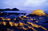 Giant's Causeway, Basalt Columns at the coastline in the light of the evening sun, County Antrim, Ireland, Europe, The Giant's Causeway, World Heritage Site, Northern Ireland