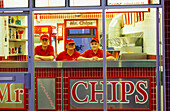Vendors at an illuinated snack in the evening, Portrush, County Antrim, Ireland, Europe