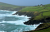Surge in front of peninsula Dingle on a rainy day, County Kerry, Ireland, Europe