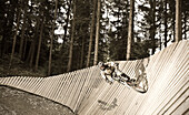 A teenager driving a ground loop on his mountain bike, Downhill Park, Wagrain, Austria
