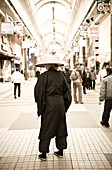 Old man wearing a hat at a shopping mall, Sapporo, Hokkaido, Japan, Asia