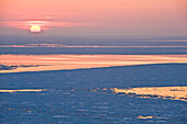 Ice floes on the pacific ocean at sunset, Hokkaido, Japan, Asia