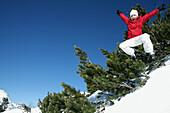 Boy in mid-air, See, Tyrol, Austria