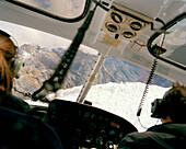 Rea view of two pilots inside a helicopter, Franz Josef and Fox Glaciers, Westland National Park, west coast, South Island, New Zealand