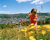 Children playing on Mount Victoria, above downtown, Lambton Harbour bay, Wellington, North Island, New Zealand