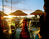 People at the Bar for yachtsmen in the light of the evening sun, Viaduct Harbour, Auckland, North Island, New Zealand