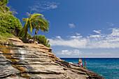 Tourists at Chinawall Rocks at Kawaihoa Point, Oahu, Pacific Ocean, Hawaii, USA