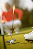 Golfer putting, Strasslach-Dingharting, Bavaria, Germany