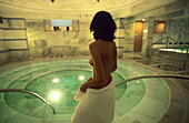 Woman at the Mineral spa pool of the Roman Irish Baths in Scuol, Lower Engadine, Engadine, Switzerland
