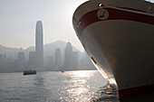 View at a ship's bow and the high rise buildings of Hong Kong Island, Hong Kong, China, Asia