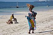 Kenyan woman with baby at Shanzu Beach, Mombasa, Kenya, Africa