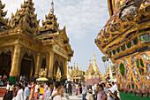 People in front of the Prayer hall in the Shwedagon Pagoda at Yangon, Rangoon, Myanmar, Burma