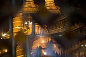 Reflections of the golden stupa of the Botataung Pagoda at night, Yangon, Rangoon, Myanmar, Burma