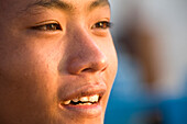Face of a burmese boy of the Intha tribe at Inle Lake, Shan State, Myanmar, Burma