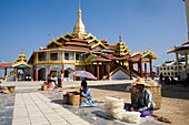 Market vendors in front of a Pagode at Inle Lake, Shan State, Myanmar, Burma