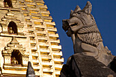 Animal figure in front of a Pagode with golden Stupa in Bagan, Myanmar, Burma