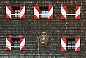 Windows with red and white shutters of an alpine lodge, National Park Hohe Tauern, Tyrol, Austria