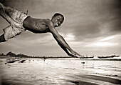 Smiling boy diving. Gambia