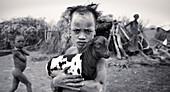 Dasanech boy with goat. South Ethiopia