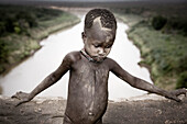 Karo boy by Omo River. South Ethiopia. African Tribes