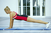Activity, Adult, Adults, Calisthenics, Callisthenics, Caucasian, Caucasians, Color, Colour, Contemporary, Exercise, Exercising, Female, Fitness, Floor, Floors, Full-body, Full-length, Horizontal, Human, One, One person, People, Person, Persons, Press-up,