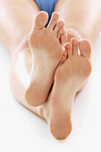Adult, Adults, Barefeet, Barefoot, Body, Body care, Body part, Body parts, Close up, Close-up, Closeup, Color, Colour, Contemporary, Detail, Details, Feet, Female, Foot, Human, Indoor, Indoors, Inside, Interior, One, One person, People, Person, Persons, S