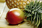 Aliment, Aliments, Close up, Close-up, Closeup, Color, Colour, Food, Fruit, Fruits, Healthy, Healthy food, Horizontal, Indoor, Indoors, Inside, Interior, Mango, Mangoes, Nourishment, Pair, Pineapple, Pineapples, Still life, Tropical fruit, Tropical fruits