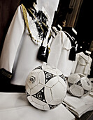 Ball, Balls, Catholicism, childhood, Christian, Christianity, Clothes, Color, Colour, Concept, Concepts, Daytime, exterior, First Communion, Football, Glass, infancy, outdoor, outdoors, outside, Reflection, Reflections, Religion, Roman Catholic, Sacrament