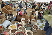 Aymara women selling potatoes and other vegetables at a street market in El Alto. Bolivia