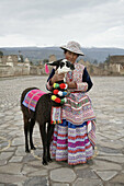 Woman in traditional dress, with alpaca, Yanque, Colca Canyon, Peru